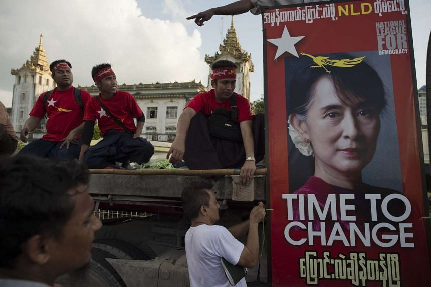 Supporters of Myanmar opposition leader Aung San Suu Kyi's National League for Democracy (NLD) setting up a stage in Yangon on Nov 5, 2015.