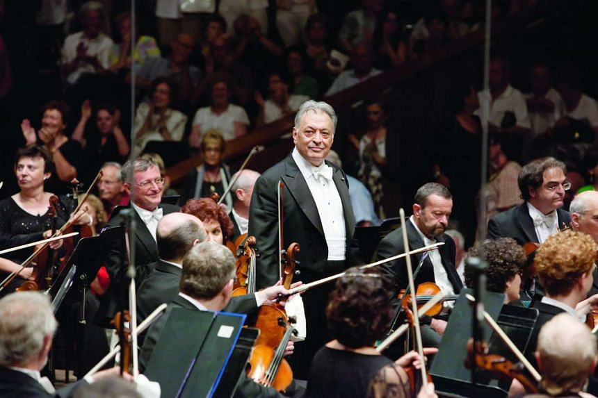 Maestro Zubin Mehta (centre) with members of the Israel Philharmonic Orchestra.