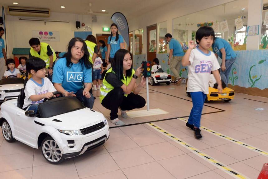 Children learning how to use the road at the AIG road safety education programme on Feb 2 2015.