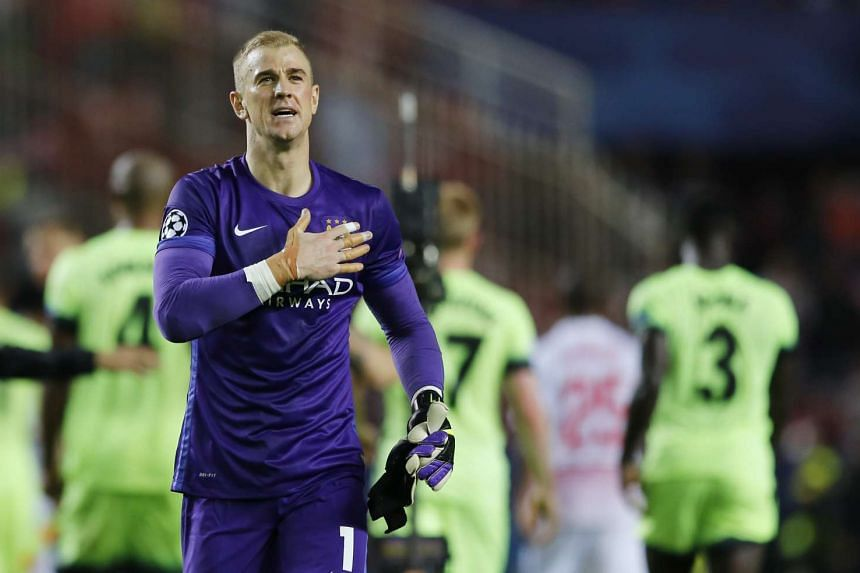 Manchester City's Joe Hart gestures to their fans after the match between Sevilla and Manchester City.
