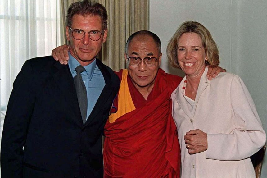 Harrison Ford (left) and Melissa Mathison (right) with Tenzin Gyatso, the 14th Dalai Lama of Tibet, on Aug 1, 1996.