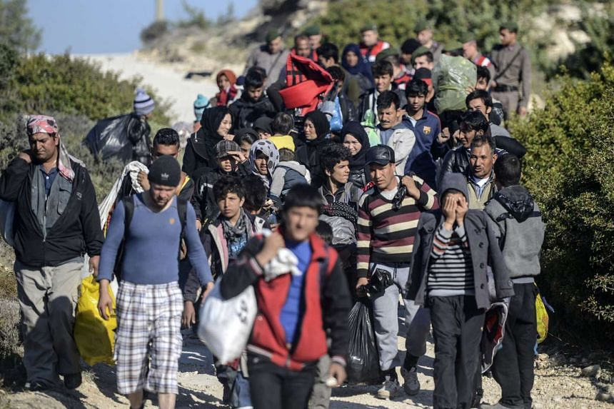 A group of refugees, led by Turkish police, are escorted to buses in place of sailing to the Greek island of Chios via rafts.