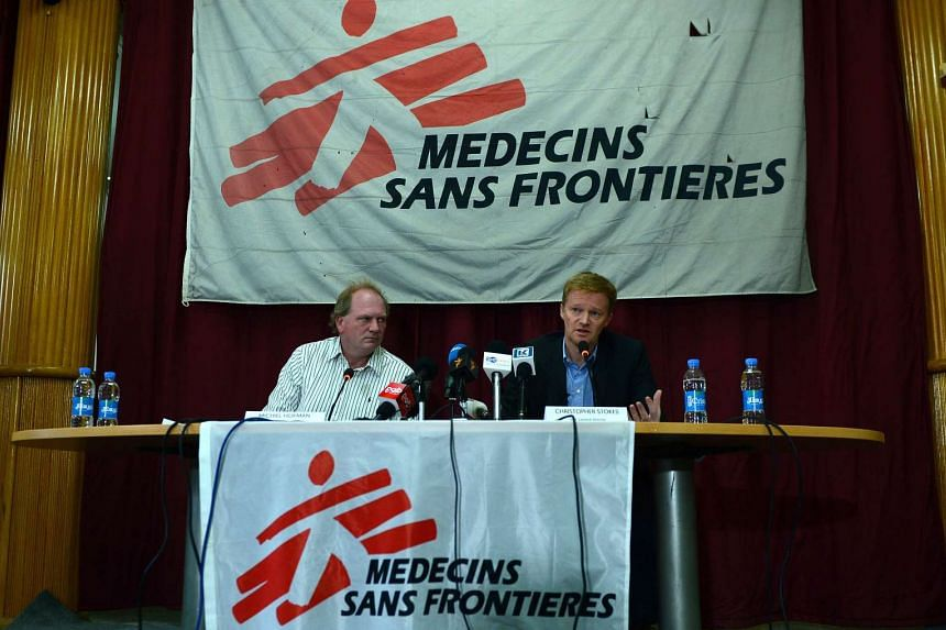 General Director of Médecins Sans Frontières (MSF), Christopher Stokes (right) speaks during a press conference.