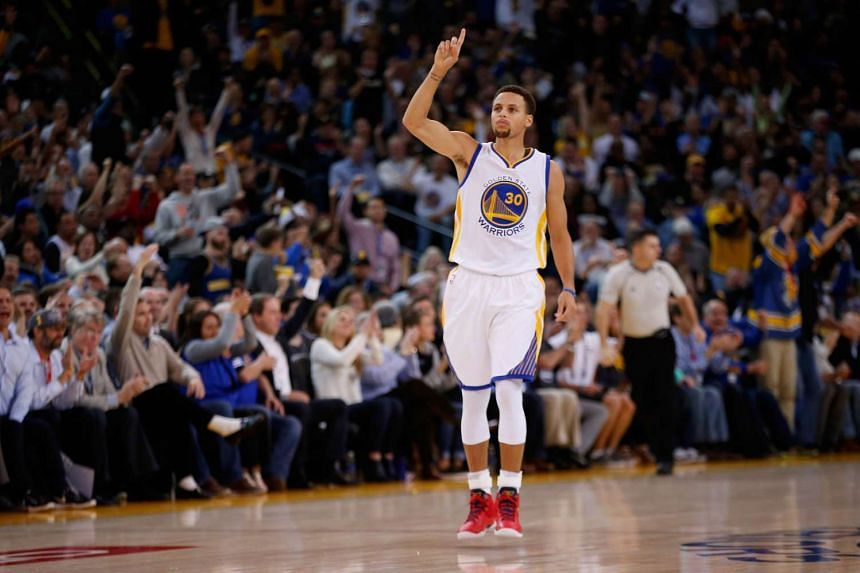 Stephen Curry of the Golden State Warriors reacts after making a three-point basket against the Los Angeles Clippers.
