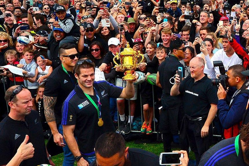 All Blacks captain Richie McCaw holding the Webb Ellis Cup during a victory parade at Victoria Park.