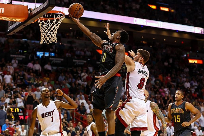 Atlanta guard Jeff Teague driving to the basket, with Miami guard Tyler Johnson defending during the second half at American Airlines Arena. The Hawks won 98-92, proving to their detractors that the East's No. 1 seeds should not be discounted so easi