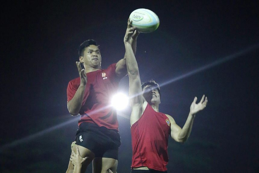 Hooker Zaki Mahmood, 29, and winger Bronson Ro, 19, jumping at a line-out during the sevens team's final training session on Tuesday, before departing for the Olympic qualifiers in Hong Kong.