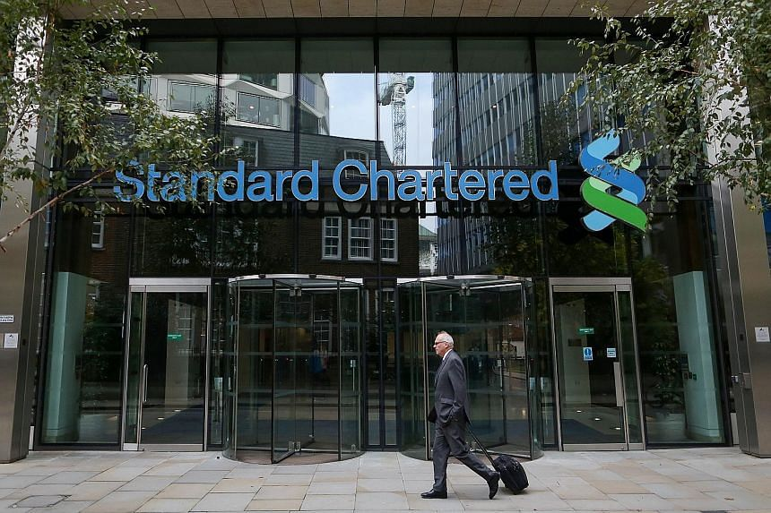 The StanChart headquarters in London. Seeking a turnaround in fortunes, the company is now axing 15,000 jobs and is being forced to ask investors for US$5.1 billion (S$7.1 billion).