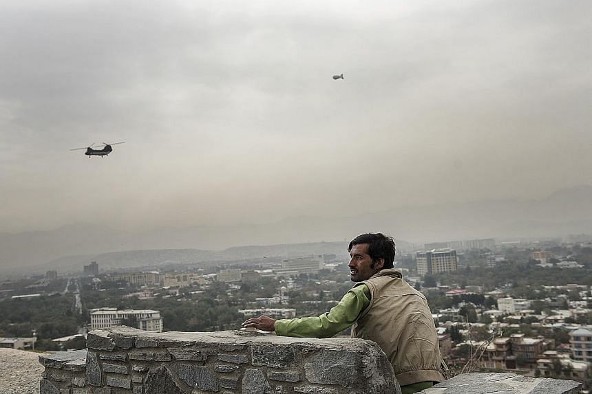Helicopters in Kabul ferrying people working with the US and international coalition to their offices and back, as a security blimp keeps watch over the city. The helicopter transport is just one measure of how things have changed in the Afghan capit