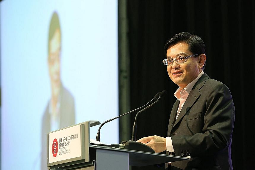 """Mr Heng Swee Keat speaking at the Semi-Centennial Leadership Conference at the Suntec convention centre yesterday. Mr Heng said companies function as the """"building blocks of our economy""""."""