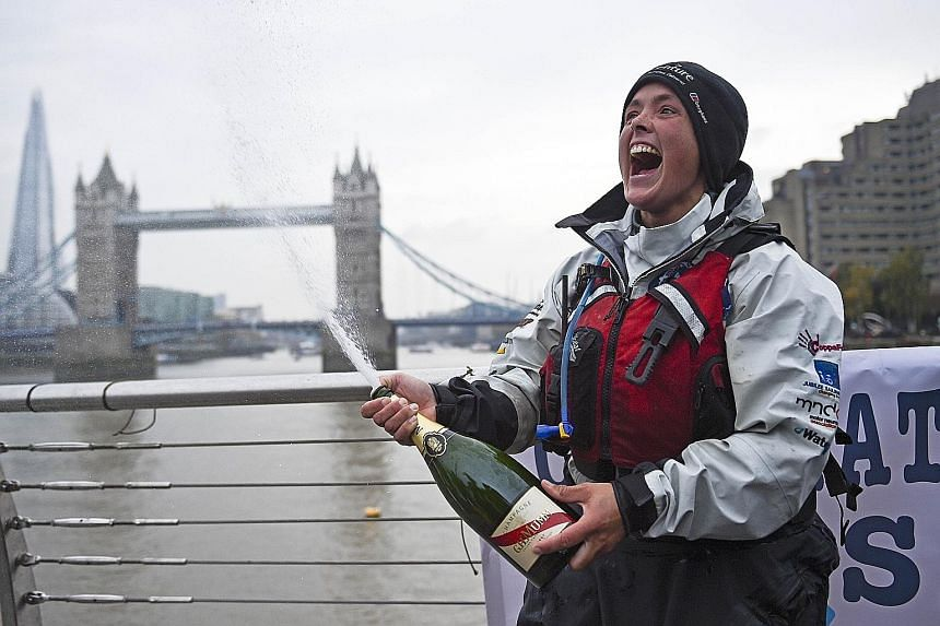 British adventurer Sarah Outen celebrating the completion of her London2London: via the World expedition on Tuesday.