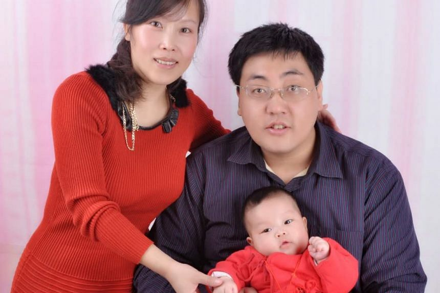 Teacher Miao Chunlei, 39, with her husband Wang Cheng, 36 and daughter Wang Ruohan, 3. This picture was taken in 2012.