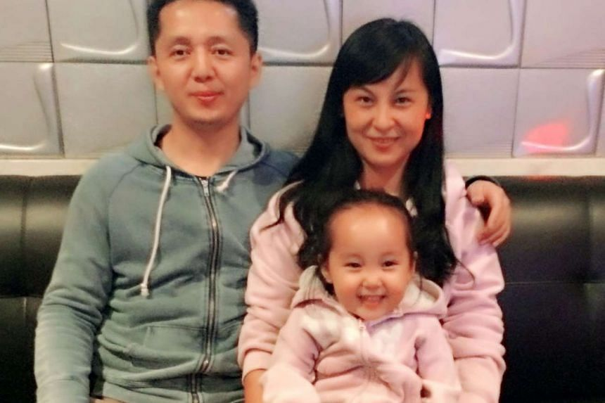 Housewife Xiang Yuanfang, 37, with her husband and furniture designer Dong Yitao, 39 and daughter Dong Mingxi, 3.