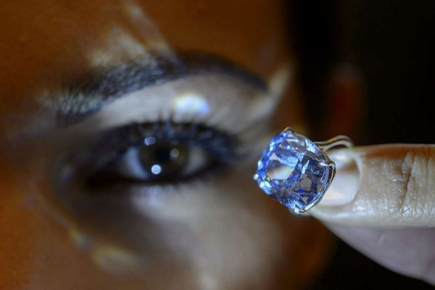 A Sotheby's employee displays the rare Blue Moon Diamond.