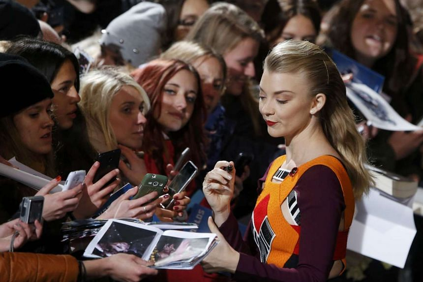 Natalie Dormer signing autographs as she arrives for the world premiere of The Hunger Games: Mockingjay - Part 2 in Berlin, Germany, on Nov 4, 2015.