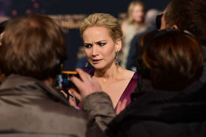 Jennifer Lawrence speaking to journalists as she arrives for the world premiere of the movie The Hunger Games: Mockingjay — Part 2, in Berlin on Nov 4, 2015.