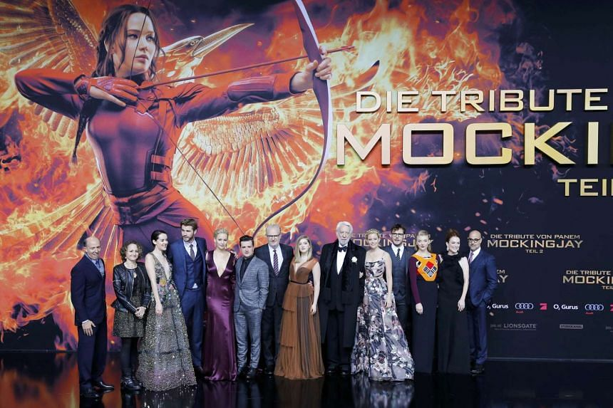 The cast and crew of the film posing as they arrive for the world premiere of The Hunger Games: Mockingjay - Part 2 in Berlin, Germany, on Nov 4, 2015.