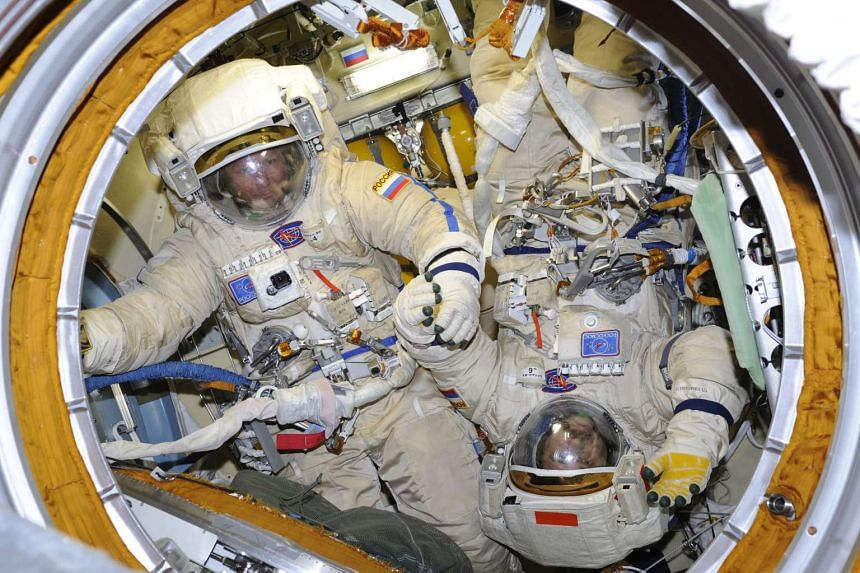 International Space Station crew members prepare for a spacewalk on Aug 7, 2015.