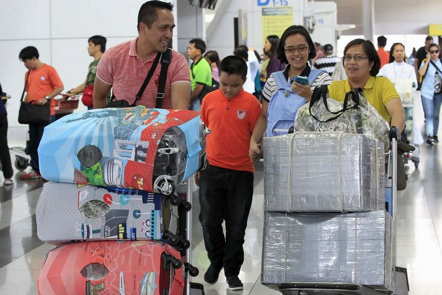 """Travellers alarmed by the """"bullet-planting"""" scam are choosing to have their bags sealed with plastic or wrapping their luggage with masking tape. Victims of the scam have included old women, travellers in wheelchairs and Filipinos bound for jobs"""