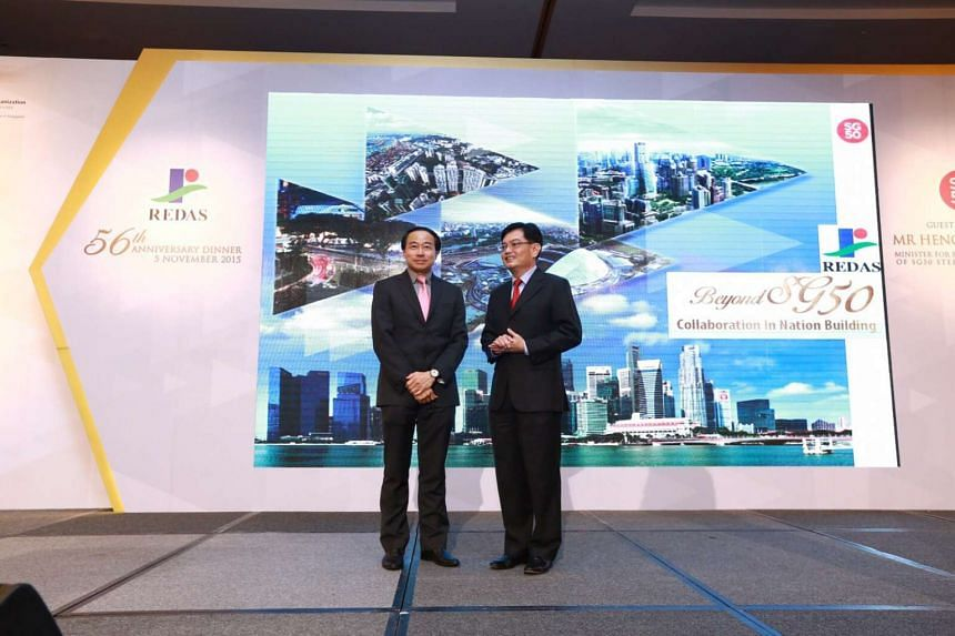 Real Estate Developers' Association (Redas) president Augustine Tan and Finance Minister Heng Swee Keat at the function. PHOTO: REDAS