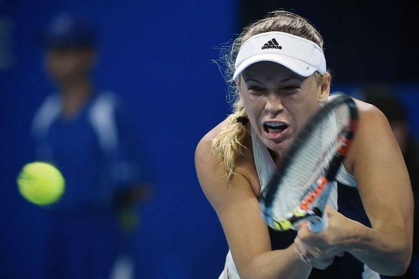Wozniacki (above) ended up with a wrist injury after a bread knife cut meant she couldn't hold her racquet properly.
