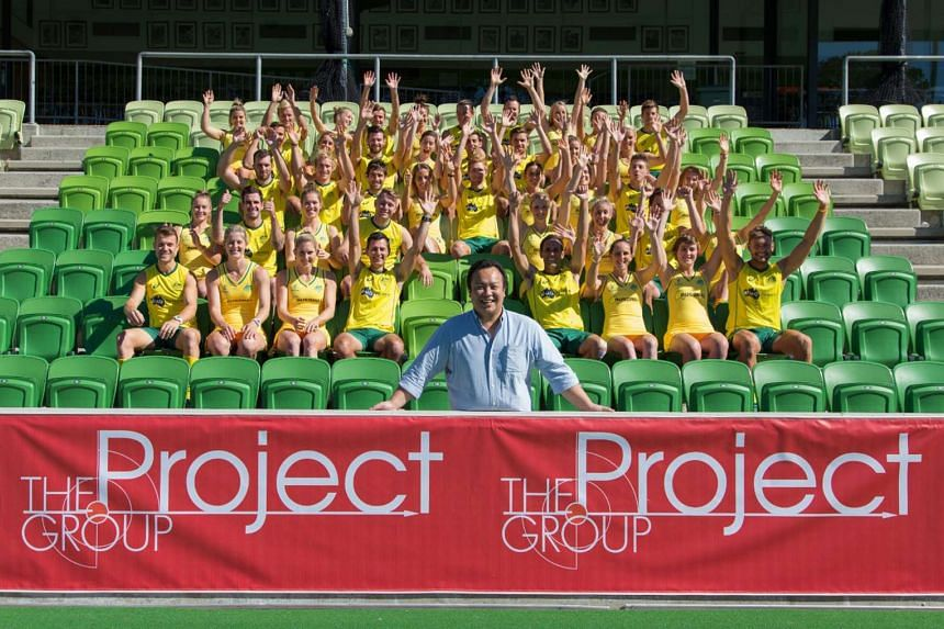 TPG managing director Paul Lim (front) with the Australian national men's and women's teams. Australia's national women's team will be in Singapore for the inaugural International Tri-Series.