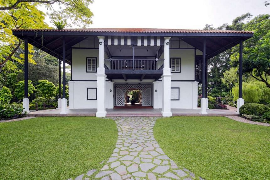 Burkill Hall, a black-and-white colonial bungalow within the Singapore Botanic Gardens.