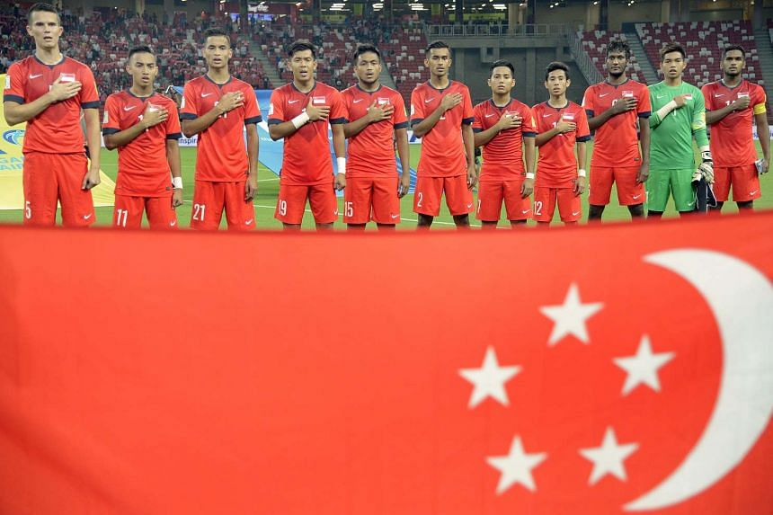 The Singapore national football team singing the national anthem during the Fifa World Cup qualifier against Cambodia on Oct 13, 2015.