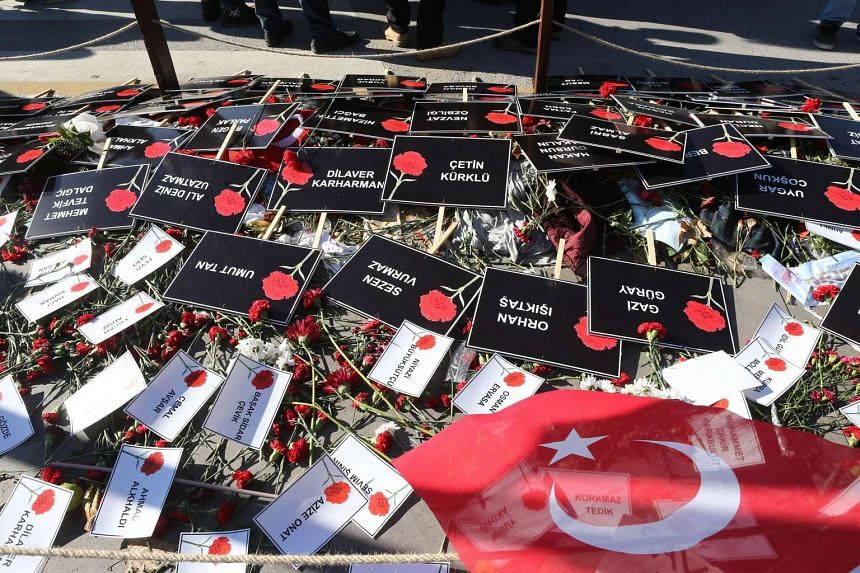 Signs with the names of victims of the double suicide bombing blamed on IS militants in Ankara, Oct 26.