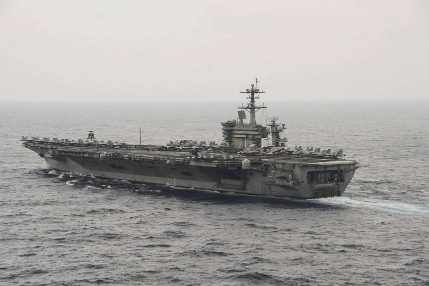 The aircraft carrier USS Theodore Roosevelt (CVN 71) transits the South China Sea.