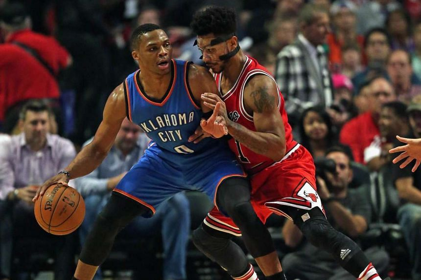 Russell Westbrook (0) of the Oklahoma City Thunder moves against Derrick Rose (1) of the Chicago Bulls.