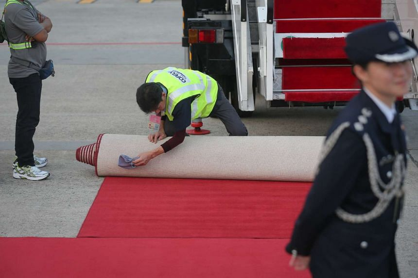 Airport staff prepare the red carpet VIP Complex at Changi Airport for Chinese President Xi Jinping's arrival.