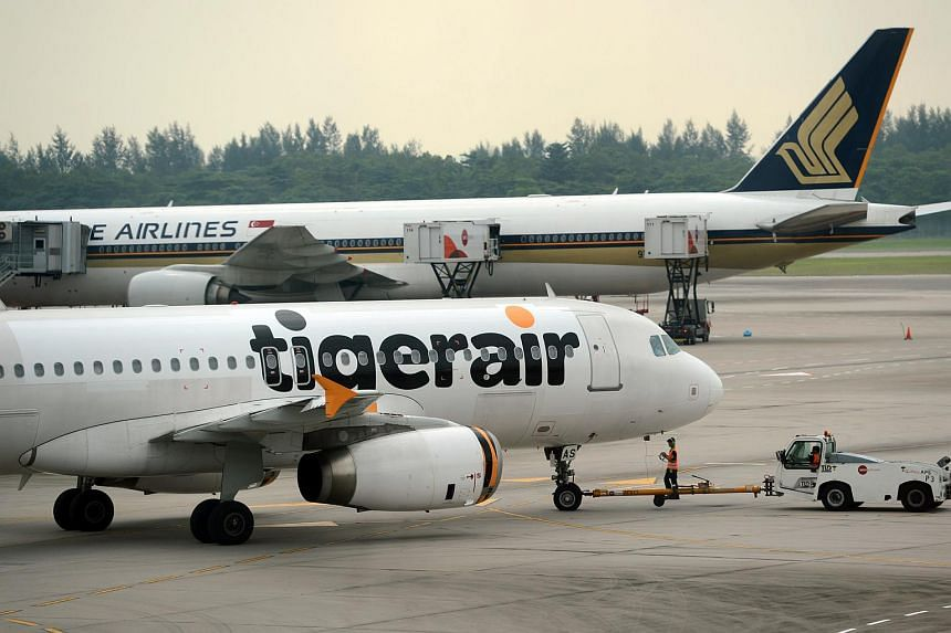 A Tigerair and SIA plane at Changi Airport in 2013.