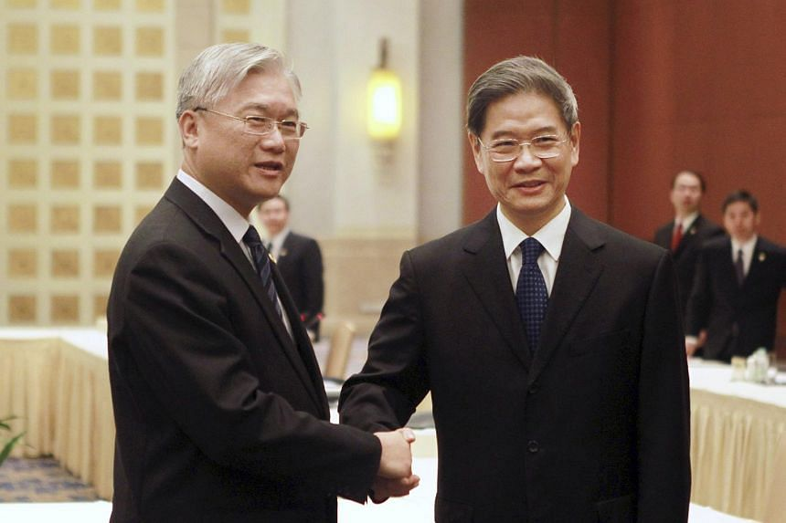 Mr Zhang Zhijun (right), director of China's Taiwan Affairs Office, shakes hands with Mr Andrew Hsia, chairman of Taiwan's Mainland Affairs Council, on Oct 14, 2015.