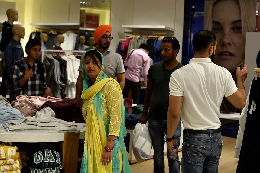 Customers at a multinational clothing store in New Delhi on Oct 31.