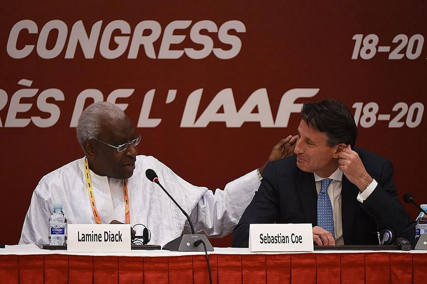 """Former IAAF president Lamine Diack (left) congratulating his newly elected successor, Sebastian Coe, in Beijing on Aug 19. Diack, memorably hailed by Coe as being """"my spiritual president"""", is suspected of pocketing a seven-figure sum to cover up seve"""