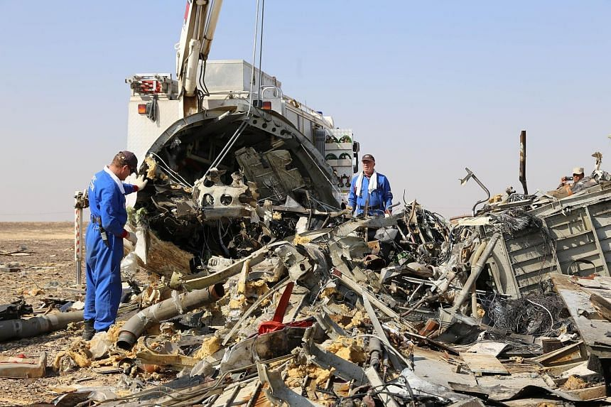 Russian emergency services personnel working at the plane's crash site in Wadi al-Zolomat, a mountainous area of Egypt's Sinai peninsula, in a handout picture from Russia's Emergency Ministry.