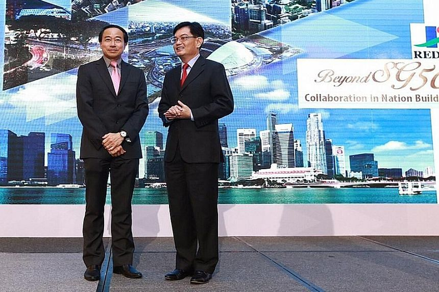 Redas president Augustine Tan (left) and Finance Minister Heng Swee Keat both outlined the challenges faced by the property industry at the association's 56th anniversary dinner at Marina Bay Sands last night.