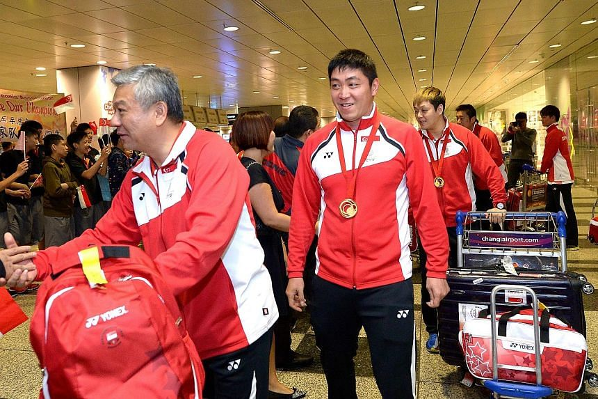 Yang Chuanning (left), with national player Gao Ning after returning from a tournament, feels he is an innocent victim of the internal turmoil in the Singapore Table Tennis Association. However, it is understood that the players have voiced their unh