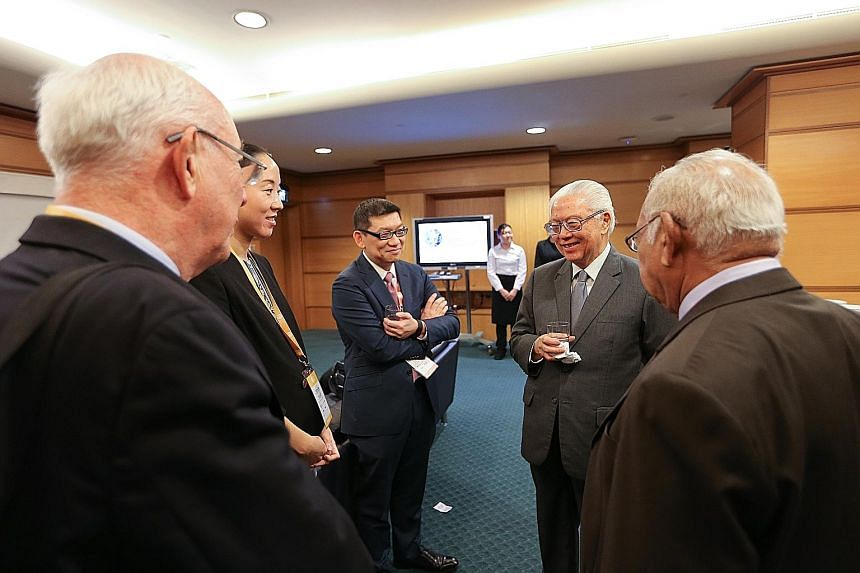 President Tan (second from right) at a tea reception during the conference of the Nobel Prize Series yesterday. He said students must be equipped with the competencies to thrive in the workforce of the future.