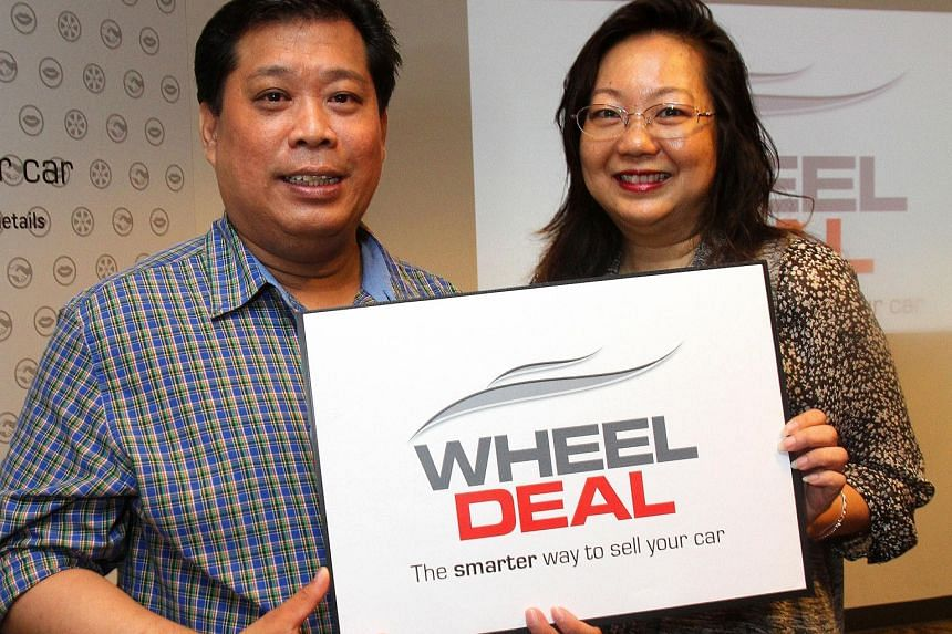 Mr Ken Soo, pictured here with his wife Valerie Lim, sold his seven-year-old Toyota Alphard for $58,000 via Wheel Deal after failing to get a suitable quote from other avenues.