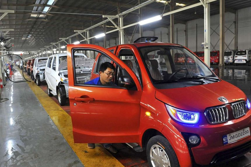 An employee assembles an electric car at a factory in Qingzhou, China, on Oct 31, 2015.