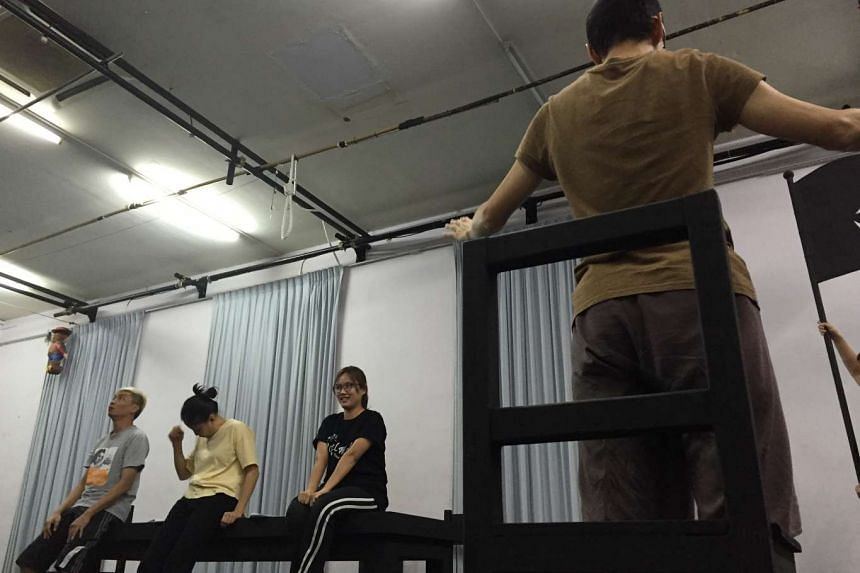 The cast of The Spirits Play rehearsing.