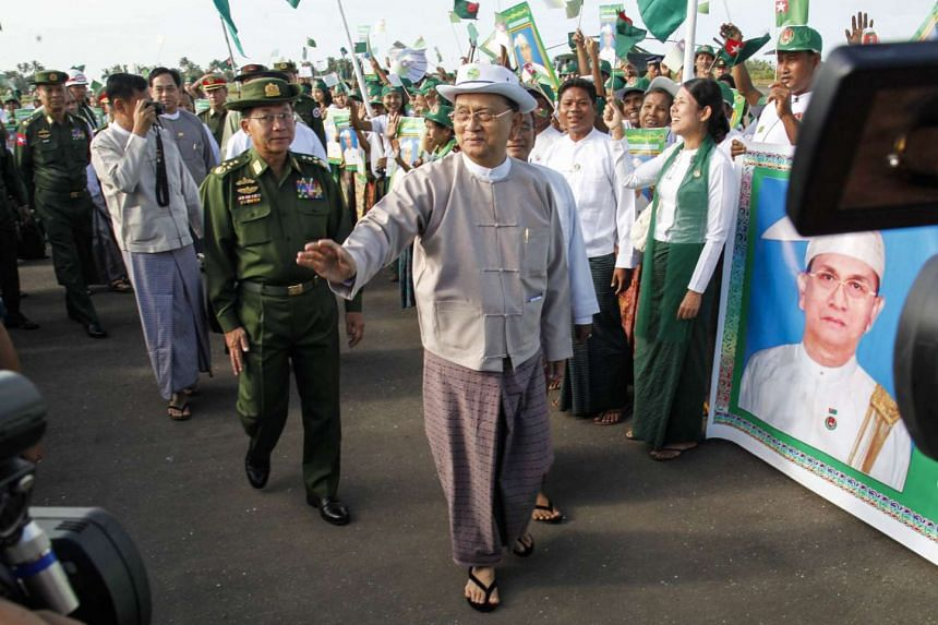 Myanmar's President Thein Sein (centre) arriving at Sittwe airport, Rakhine State, on Nov 3.
