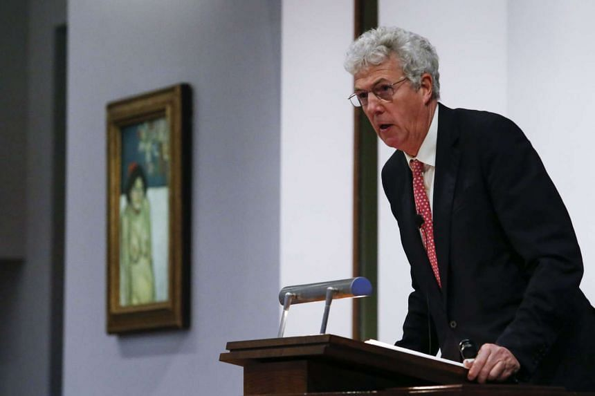 Auctioneer Henry Wyndham showing Picasso's La Gommeuse (left) at Sotheby's on Nov 5 in New York.