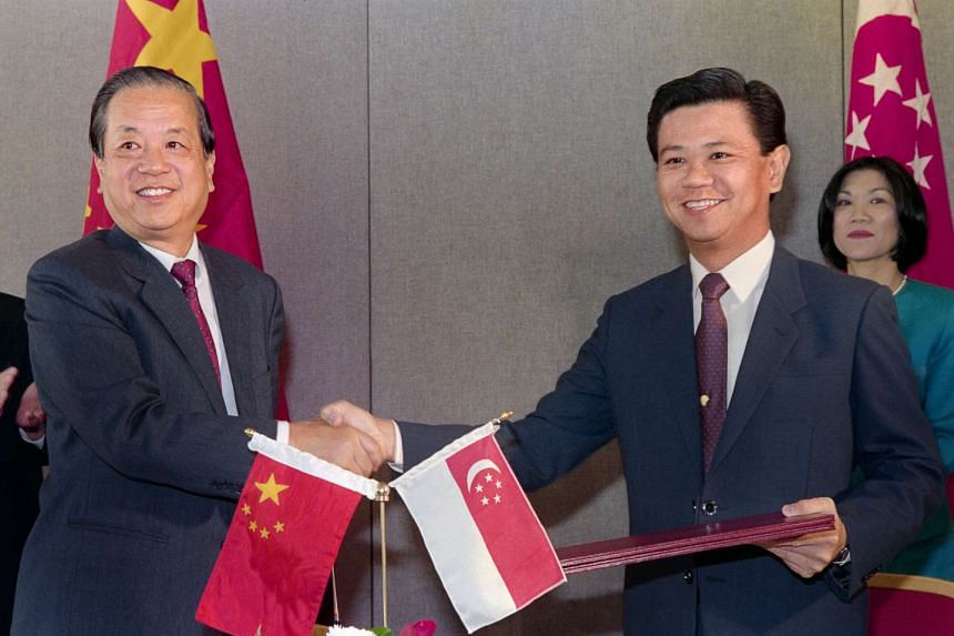 Singapore's then Foreign Minister Wong Kan Seng (at right) with his Chinese counterpart Qian Qichen after signing a communique formalising diplomatic ties on Oct 3, 1990.