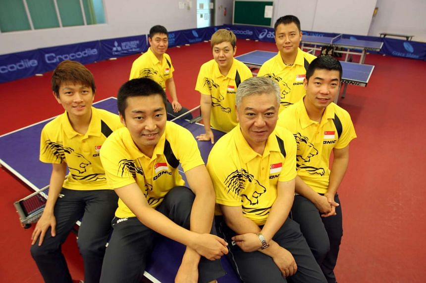 "The STTA said Yang Chuanning (front row, third from left, in a photo taken in July last year) was sacked after ""extensive consultation with the players of the men's team"". Assistant coaches Zhu Jiang (back row, right) and Wang Xiang (not in pic"