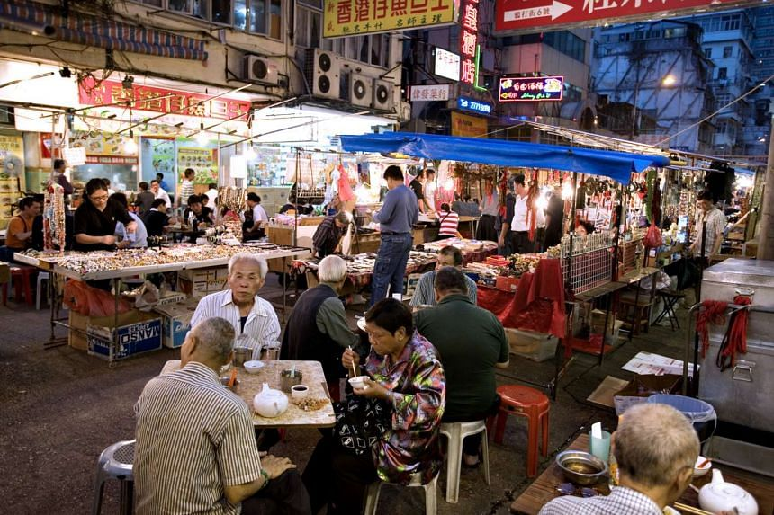 Patrons at the Temple Street Night Market in Hong Kong in 2007.