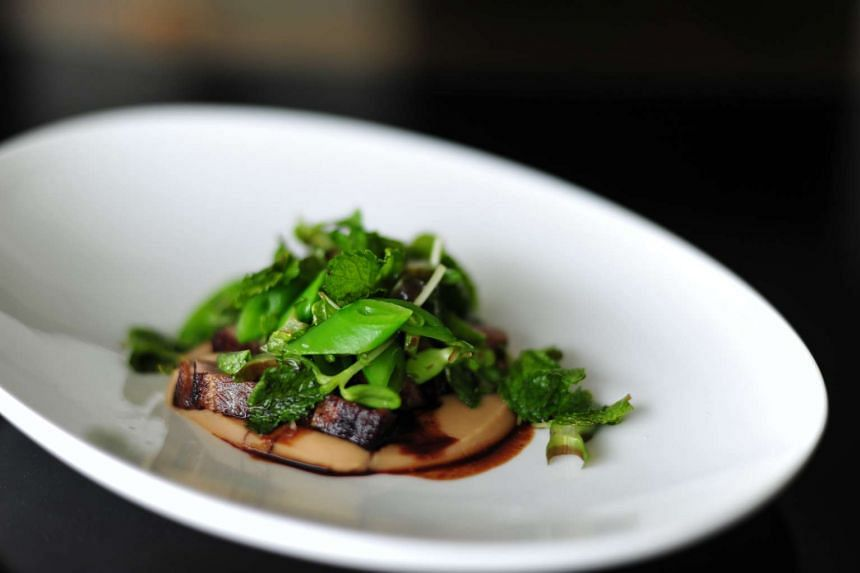 Quick-seared pork collar with butter bean puree and mint salad.