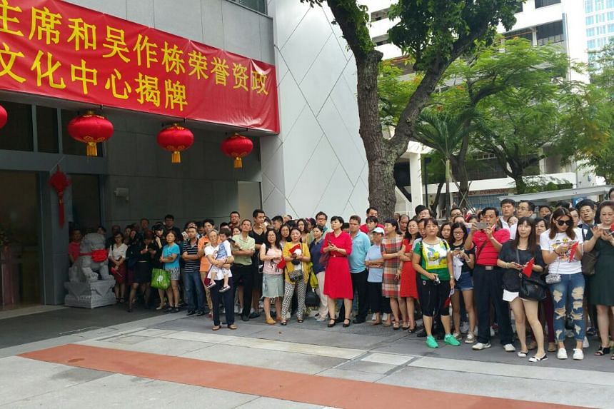 The crowd waiting for the arrival of Chinese President Xi Jinping outside the China Cultural Centre on Saturday morning.